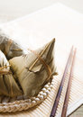 Chinese sticky glutinous rice dumplings on bamboo place mat Stock Image