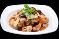 Chinese stir fry chicken and mushroom  isolated on black background, chinese cuisine Royalty Free Stock Photo