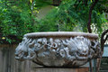 Chinese stone carving dragon stonecarving basin in garden Royalty Free Stock Image