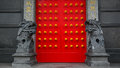 Chinese stone lion in the temple with red door Royalty Free Stock Photo