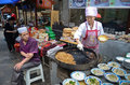 Chinese street cooking muslim men on the streets of xian china Stock Images