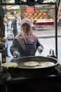 Chinese street cooking muslim woman on the streets of xian china Stock Images