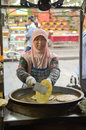 Chinese street cooking muslim woman on the streets of xian china Stock Photos