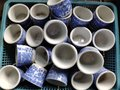 stock image of  Chinese style cups used for drinking tea Placed on the blue basket.