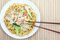 Chinese style deep fried yellow noodles with pork chili vegetables and soup Royalty Free Stock Images