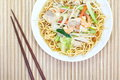 Chinese style deep fried yellow noodles with pork chili vegetables and soup Stock Image