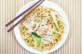 Chinese style deep fried yellow noodles with pork chili vegetables and soup Royalty Free Stock Photo