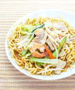 Chinese style deep fried yellow noodles with pork chili vegetables and soup Royalty Free Stock Photos