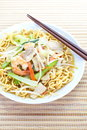 Chinese style deep fried yellow noodles with pork chili vegetables and soup Stock Images
