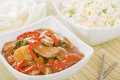 Chinese style pork with red peppers served egg fried rice and prawn crackers Stock Photography
