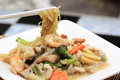 Chinese style stir fried yellow noodles with in gravy sauce noodle a creamy koy se mie Stock Photo