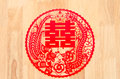 Chinese symbol of double happiness and happy marriage paper cut on the wood background this is a traditional culture Stock Photos