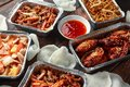 Chinese takeaway food. Crispy shredded beef, sweet and sour chicken wings, egg noodles with bean sprouts, pineapple Royalty Free Stock Photo