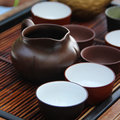 Chinese tea ceremony on bamboo table shallow depth of field Royalty Free Stock Images