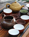 Chinese tea ceremony on bamboo table shallow depth of field Stock Photos