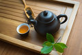 Chinese tea ceremony tealeaves teacup and teapot on the bamboo mat Royalty Free Stock Image