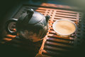 Chinese tea ceremony. Teapot and a cup of green puer tea on wooden table. Asian traditional culture. Royalty Free Stock Photo