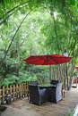 Chinese tea house with red umbrella Royalty Free Stock Photo