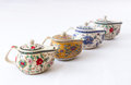 Chinese tea pots four with floral decorations on white Royalty Free Stock Image