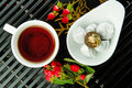 Chinese tea pu er white cup of brewd and the sauser with briquettes red flower symbolizes the harmony of ancient asia Stock Images