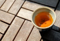 Chinese tea served in traditional handcraft japanese ceramic pottery on the wooden floor Royalty Free Stock Photos