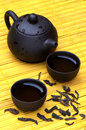 Chinese tea set wild puerh tea yellow wooden mat Royalty Free Stock Images