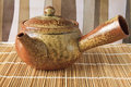 Chinese teapot on a brown textured background Royalty Free Stock Photos