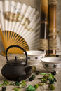 The Chinese teapot, two cups, fan and bamboo Royalty Free Stock Images