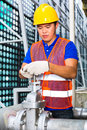 Chinese technician working on valve or engineer a building technical equipment or industrial site Stock Photos