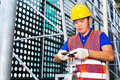 Chinese technician working on valve or engineer a building technical equipment or industrial site Royalty Free Stock Photos