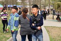 Chinese teenagers trendy haircuts walking pengzhou park sunday spring afternoon pengzhou china Royalty Free Stock Image