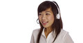 Chinese telemarketer talking and looking away from camera Stock Image
