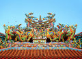 Chinese temple roof tile with dragon decoration under blue sky Stock Image