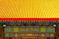 Chinese temple s roof and painting yellow tiled rooftop in Royalty Free Stock Photography