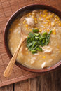 Chinese thick corn soup with chicken close up. vertical top view Royalty Free Stock Photo