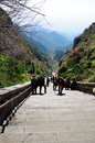 Chinese tourists climbing tai shan walking up the last set of stairs on the way to the top of mount in shandong province china Stock Photography