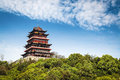Chinese traditional style tower building on a hilltop Stock Photo