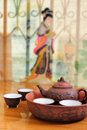 Chinese traditional teapot with cups of tea clay shallow depth field Stock Photography