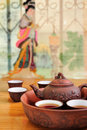Chinese traditional teapot with cups of tea clay shallow dof Royalty Free Stock Image