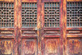 Chinese traditional wooden door with a beautiful lattice window Stock Photo