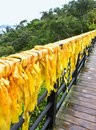 Chinese traditional yellow ribbons in yalong bay tropical park Royalty Free Stock Photos