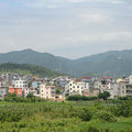 Chinese village beautiful scene of with green farm Royalty Free Stock Photography