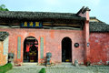 Chinese village temple there is a in the the red walls opened three arches the door has a pair of drum stones mene is a plaque Royalty Free Stock Images