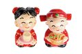 Chinese wedding couple figurines on white background Royalty Free Stock Photos