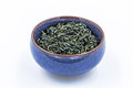 Chinese Wild Green tea. Ye Sheng Lu Cha in a blue ceramic bowl