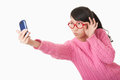 Chinese woman a beautiful using a cell phone to take a selfie on a white background Royalty Free Stock Image