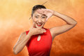 Chinese woman in cheongsam dress framing her face with hand Royalty Free Stock Photo