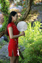 Chinese woman in cheongsam by a lake in Mudu ancient town