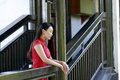 Chinese woman in cheongsam stand in wooden stairs in Mudu ancient town