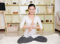 Chinese woman doing yoga at home Royalty Free Stock Images